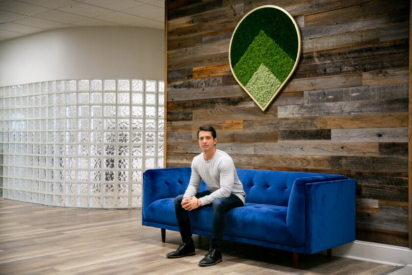 Alex Goode, CEO of the startup software company GoSite, poses for a portrait at the company's headquarters.