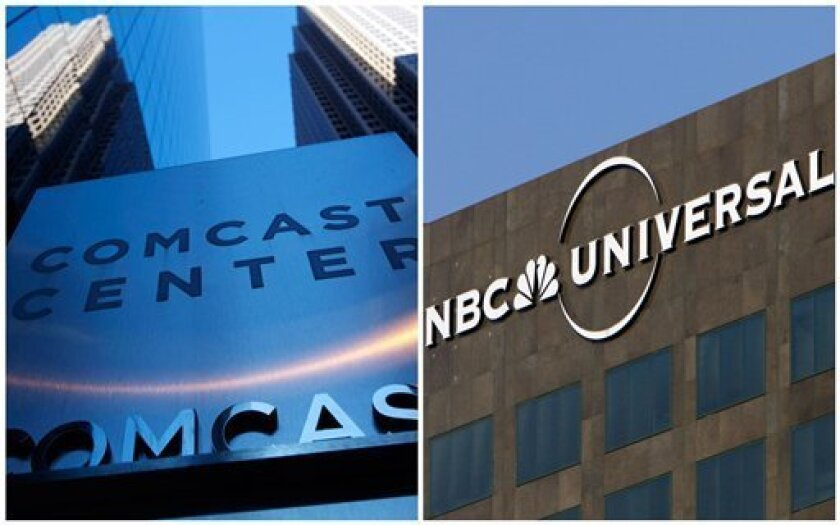 FILE - This combination of Associated Press file photos shows, left, a sign outside the Comcast Center in Philadelphia in July 2010 and right, the entrance to the Universal Studios theme park in Los Angeles, on Dec. 3, 2009. Comcast said on Tuesday, Feb. 12, 2013, that it's buying General Electric'