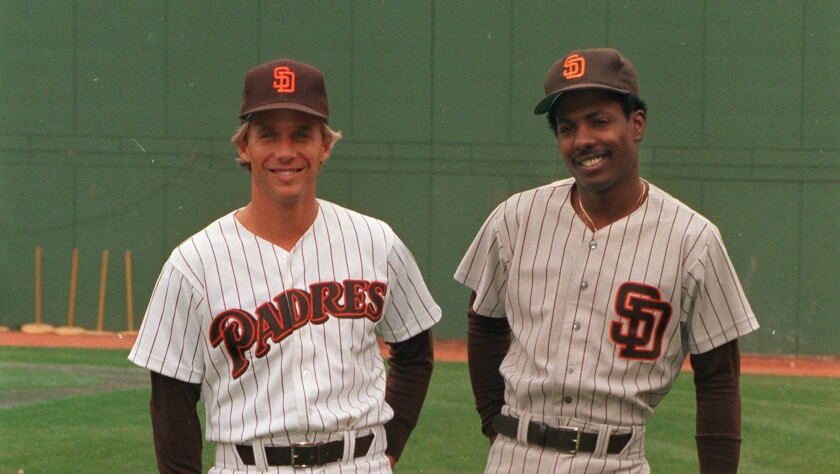 Tim Flannery, left, shows off the Padres' 1985 home uniform and second baseman Alan Wiggins models travel gray.
