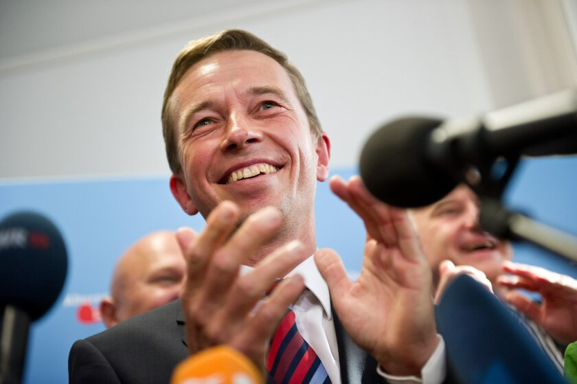 The head of the Alternative fuer Deutschland , AfD, party, Bernd Lucke, celebrates after the first exit polls for the Saxony State election , in Berlin, Sunday Aug. 31, 2014. Exit polls say the party that wants Germany to ditch the euro currency will be elected to a state assembly for the first time. The polls indicate that the party, Alternative for Germany, won 10 percent of the vote in Sunday's elections for the Saxony state parliament. (AP Photo/dpa, Daniel Naupold)