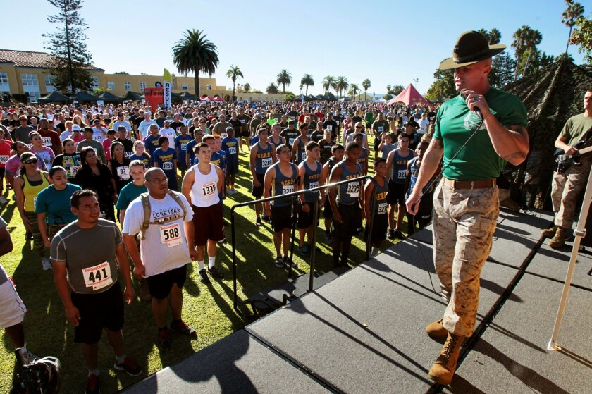 At the MCRD Boot Camp Challenge, Marine Corps Drill Instructor Sgt. Scott Ruby speaks to the crowd before the race.