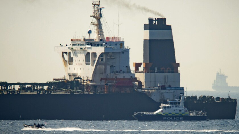 Royal Marine patrol vessel is seen beside the Grace 1 super tanker in the British territory of Gibr