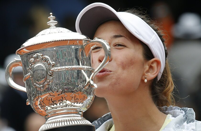 Spain's Garbine Muguruza is to kiss the cup after defeating Serena Williams of the U.S.  in their final match of the French Open tennis tournament at the Roland Garros stadium, Saturday, June 4, 2016 in Paris.  Muguruza won 7-5, 6-4. (AP Photo/Michel Euler)