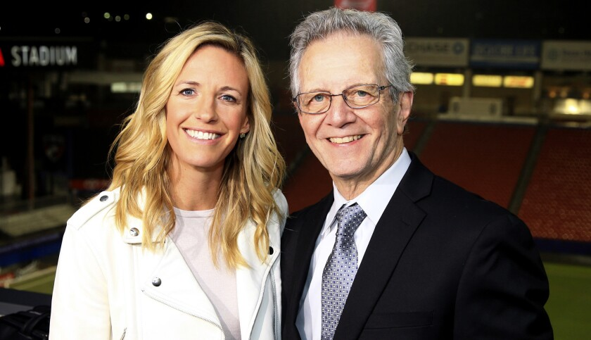 This Oct. 14, 2018, photo provided by Fox Sports shows Aly Wagner and JP Dellacamera posed at Toyota