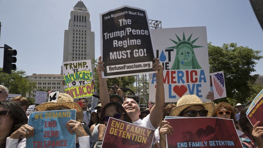 "Protesters gather downtown Saturday to demonstrate against President Trump's immigration policies and to push his administration to swiftly reunite families who were separated under his ""zero-tolerance"" border crossing policy."