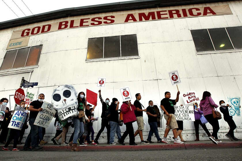 Protestors outside the Exide plant in Vernon on Oct. 30, 2013, demand the plant's shutdown. The state toxics department has struggled to regulate facilities like the one in Vernon, which has been operating for decades on only a temporary permit.