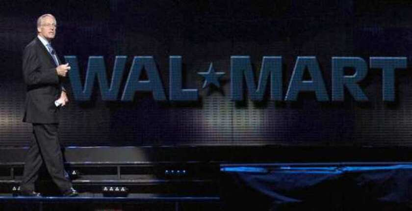 Rob Walton speaks during the annual Wal-Mart shareholders meeting in Fayetteville, Ark., in 2007. He and his relatives were worth $89.5 billion in 2010.