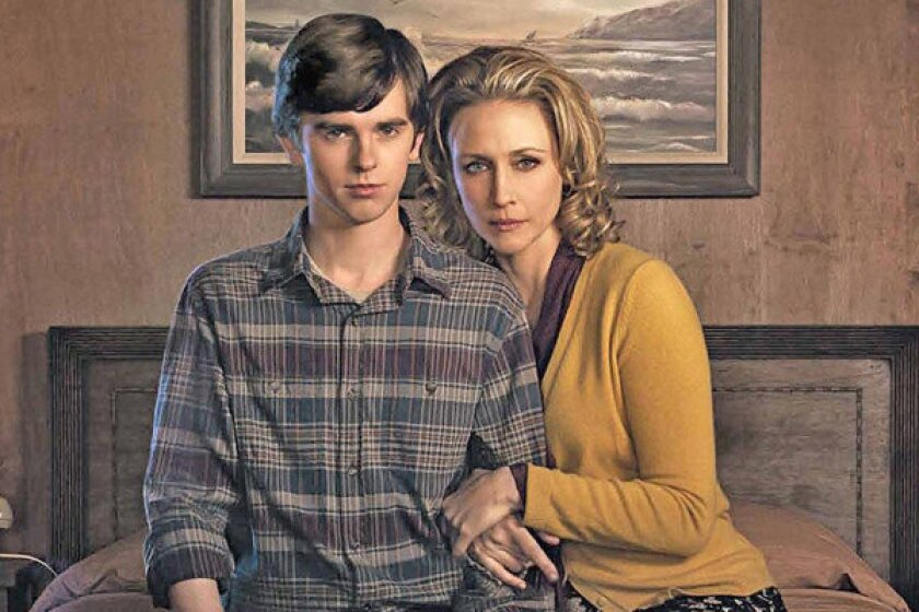 """Freddie Highmore plays Norman Bates as a teenager and Vera Farmiga plays his mother in the 10-part series """"Bates Motel."""""""