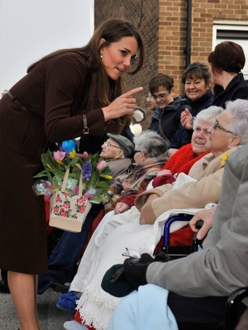 Britain's Catherine, duchess of Cambridge, talks to a group of residents of St. Andrews Hospice this year.