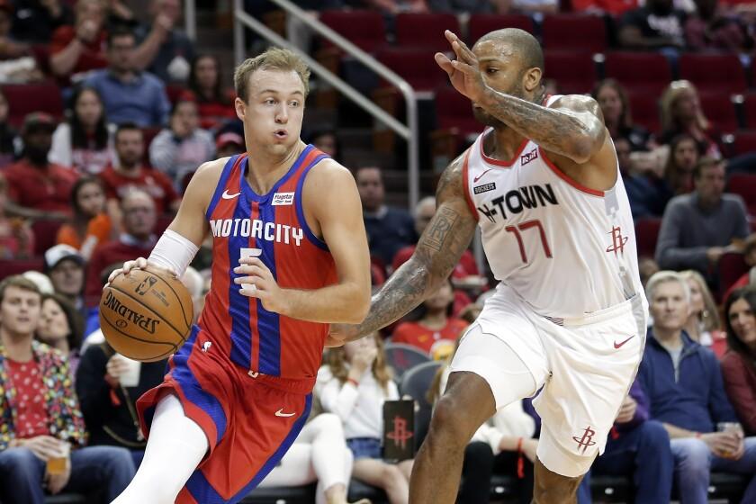 Detroit Pistons guard Luke Kennard drives around Houston Rockets forward PJ Tucker.