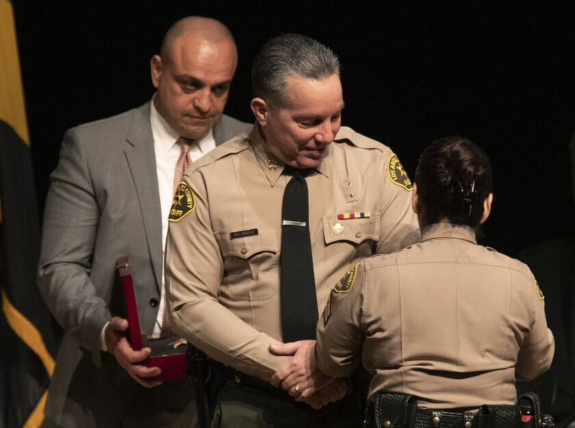 MONTEREY PARK, CA-DECEMBER 3, 2018: Los Angeles County Sheriff's Deputy Caren Carl Mandoyan, left,