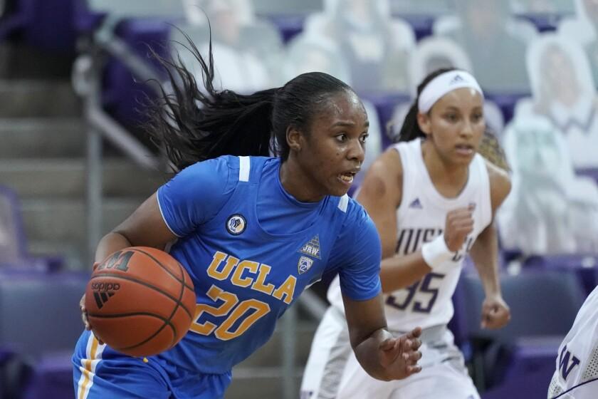 UCLA guard Charisma Osborne (20) drives against Washington during the second half.
