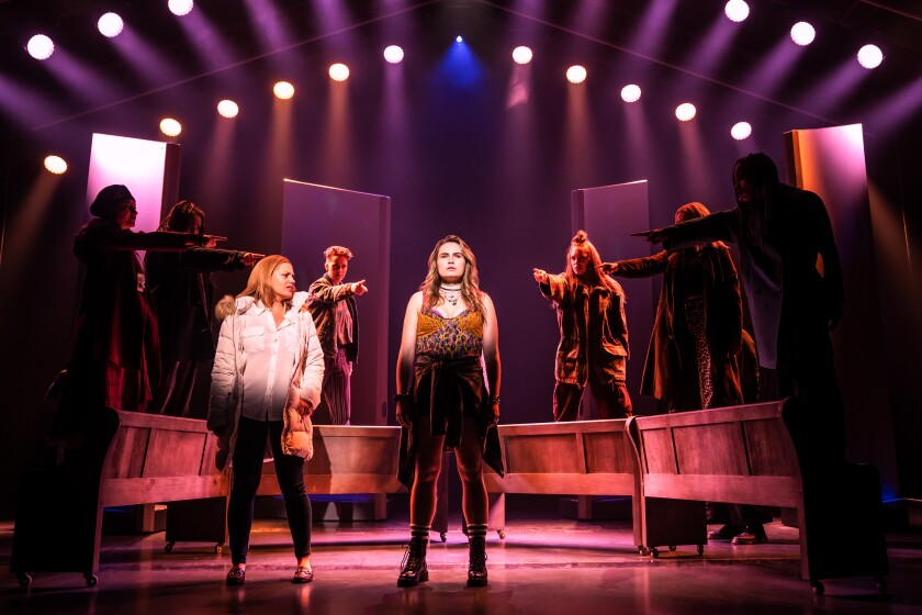 """Kathryn Gallagher in a scene from """"Jagged Little Pill"""" in which other cast members surround and point at her"""
