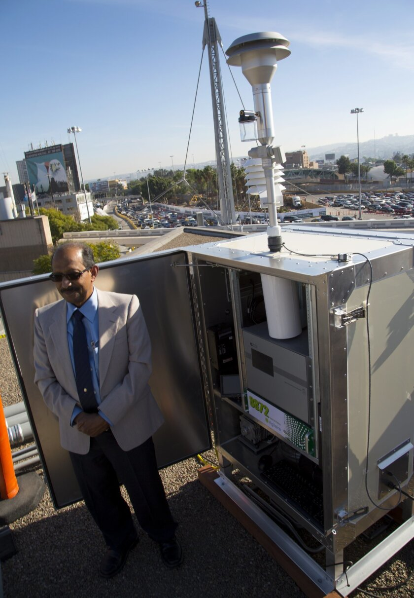 Mahmood Hossain, chief of monitoring and technical services at the San Diego County Air Pollution Control District, demonstrates the new monitor at San Ysidro.
