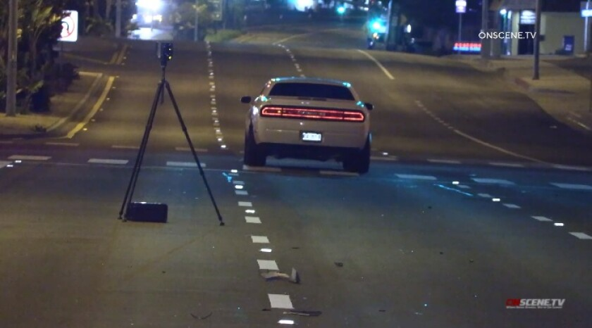 Deputies investigate Wednesday night after the driver of a Dodge Challenger struck and killed a pedestrian in Imperial Beach.