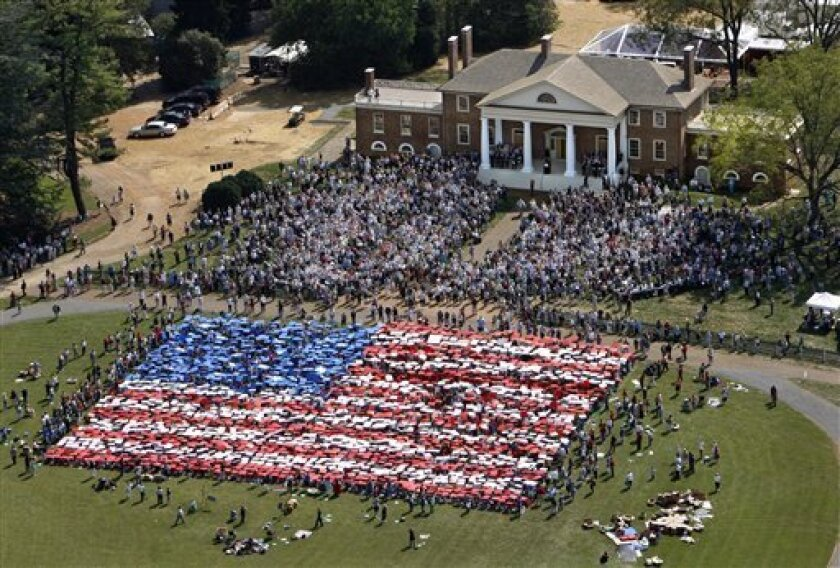 People gathered on the lawn of James Madison's home in Montpelier, Virginia, to display the U.S. flag in a card display, 2011. AP photo?