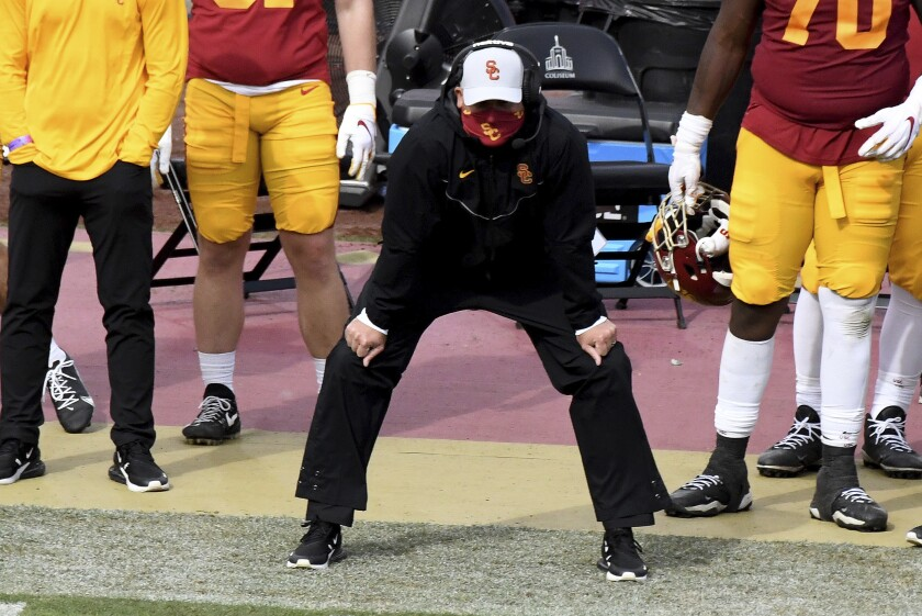 USC head coach Clay Helton watches during the second half of the Trojans' Pac-12 game against Arizona State.