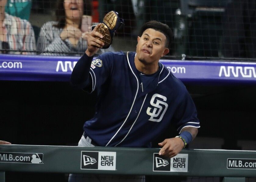 The Padres' Manny Machado yells at home plate umpire Bill Welke, who had called Machado out on strikes and then ejected him during the fifth inning of Saturday's game against the Colorado Rockies.