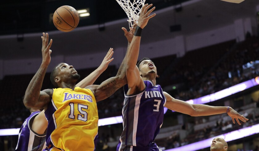 Lakers' Thomas Robinson, left, and Sacramento Kings' Skal Labissiere fight for a rebound during the second half of a preseason game on Oct. 4.
