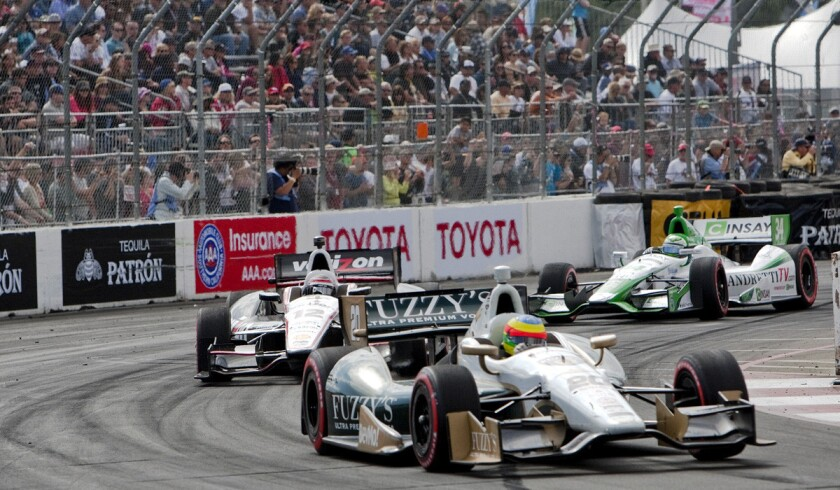 Mike Conway leads in the final laps rounding turn 10 at the Toyota Grand Prix of Long Beach on April 13, 2014.