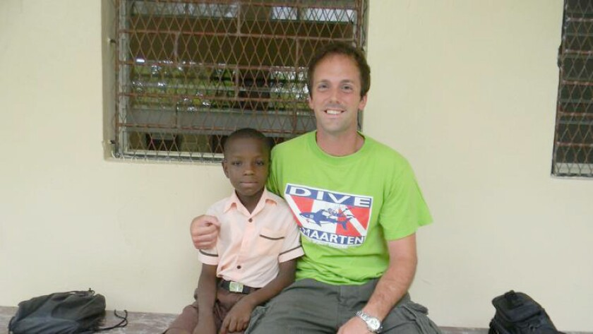 Ramona High School teacher Doug Banwart and a youth in Haiti in 2013. Banwart recently won a 2016-17 fellowship with Teachers for Global Classrooms.