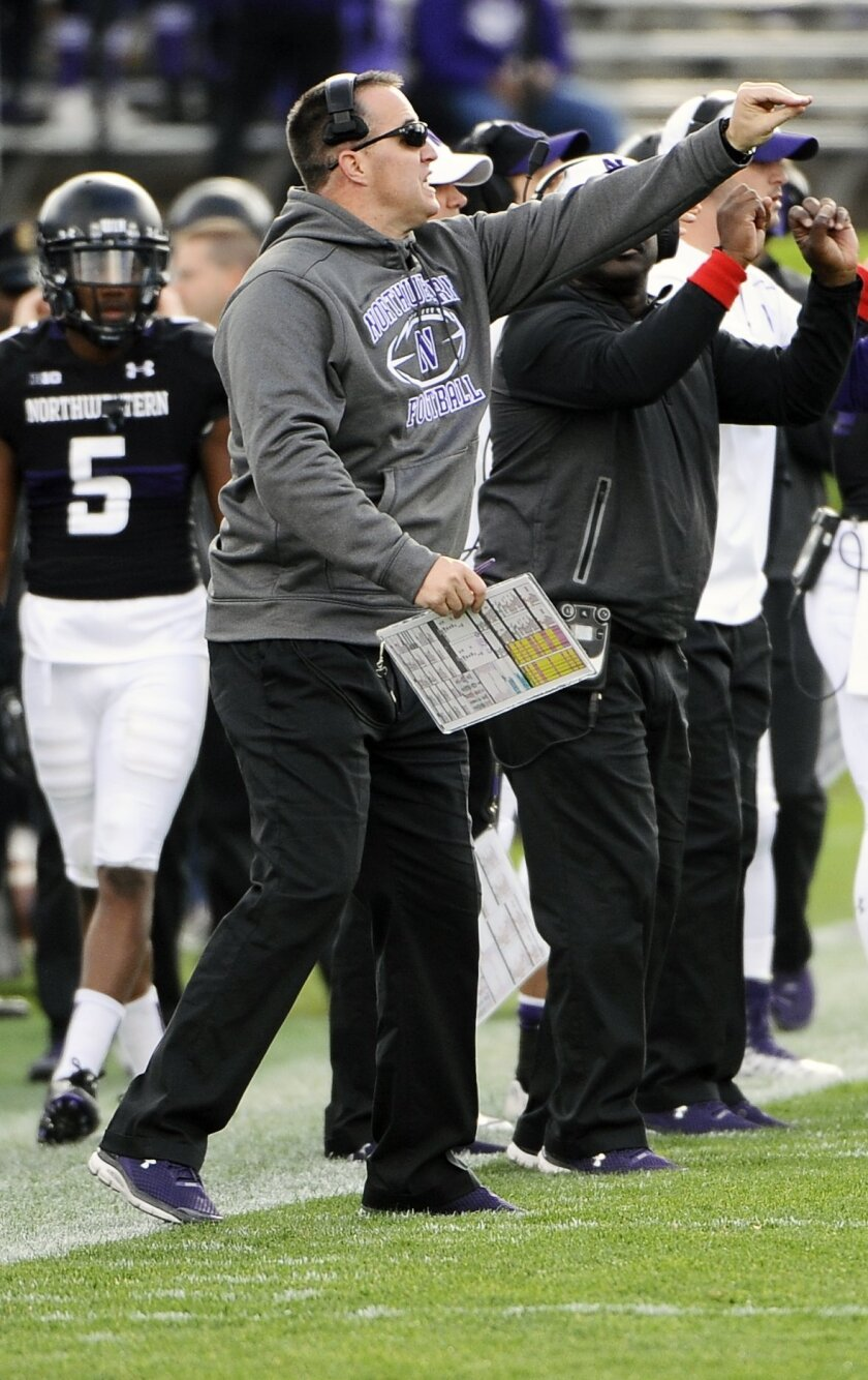 Northwestern head coach Pat Fitzgerald directs the team against Penn State during the first quarter of an NCAA college football game in Evanston, Ill.,  Saturday, Nov. 7, 2015. (AP Photo/Matt Marton)