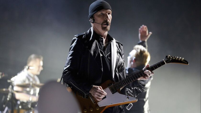 FILE - In this Sunday, Dec. 6, 2015, file photo, The Edge of U2 performs on stage during a concert,