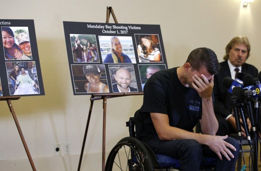 Jason McMillan, 36, of Riverside, a Riverside County Sheriff's deputy who was shot and paralyzed in the Oct, 1, 2017, Las Vegas shooting, reacts as he talks about that evening and is upset MGM's decision, during a personal account brought together by attorneys at a news conference in Newport Beach, Calif., Monday, July 23, 2018.
