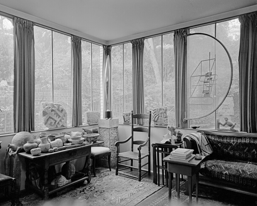 In the Arensbergs' Neutra-designed sunroom, a Duchamp relief on glass is installed in front of a window.