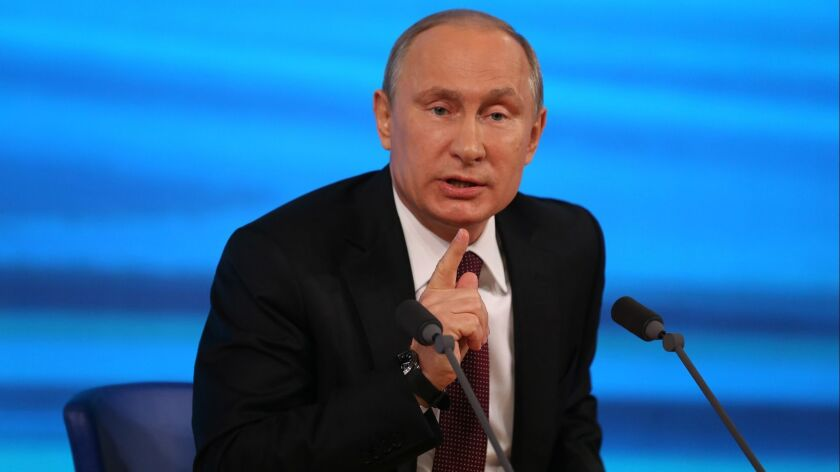 MOSCOW, RUSSIA DECEMBER 19, 2013 -- Vladimir Putin addresses a news conference in Moscow Thursday,