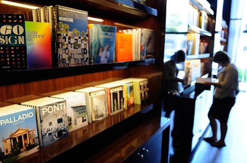 A customer browses at the Beverly Drive store whose interior was designed by Philippe Starck. Taschen retail operations give Taschen more control over the display and showcasing of its collection of art books -- producing roughly 100 new titles a year.