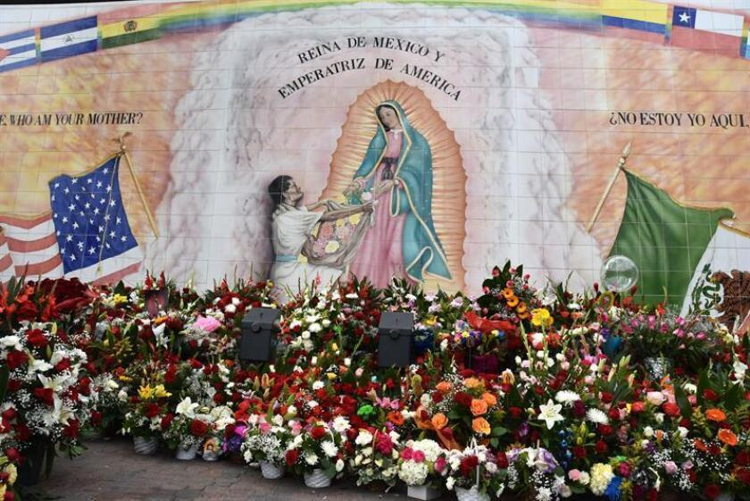 Hundreds of floral arrangements adorn a mural with the image of the Virgin of Guadalupe in Los Angeles, on 12 December 2018. EFE-EPA/ Ivan Mejia
