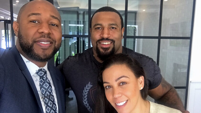 Athlete relocation specialist Ikem Chukumerije poses with his clients, Duane Brown of the Houston Te