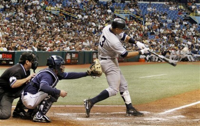 New York Yankees' Alex Rodriguez, right, hits a grand slam during the sixth inning of a baseball game against the Tampa Bay Rays in St. Petersburg, Fla., Tuesday, Oct. 4, 2009. (AP Photo/Reinhold Matay)