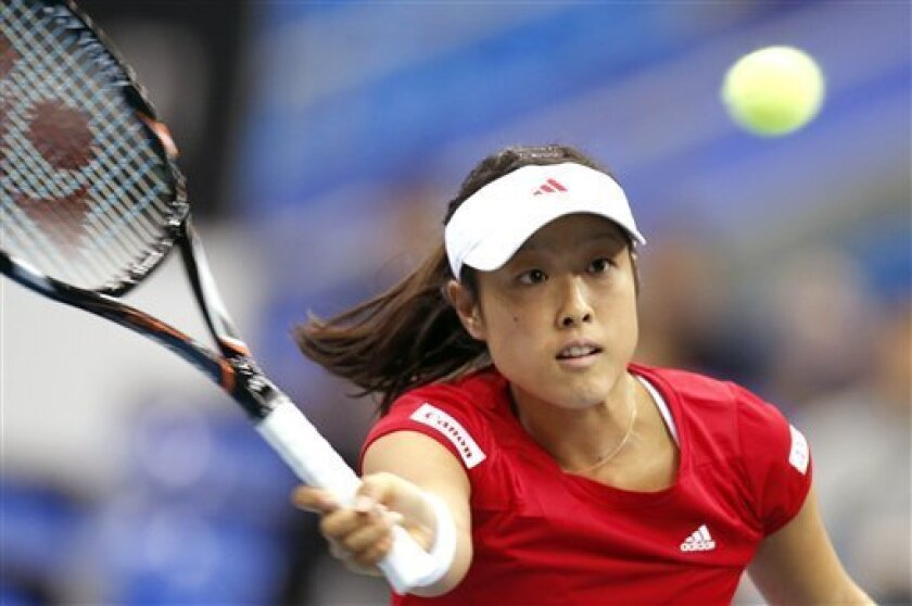 Japan's Ayumi Morita returns a shot to Russia's Ekaterina Makarova, during the Fed Cup match between Russia and Japan in Moscow, Russia, Saturday, Feb. 9, 2013. (AP Photo/Misha Japaridze)