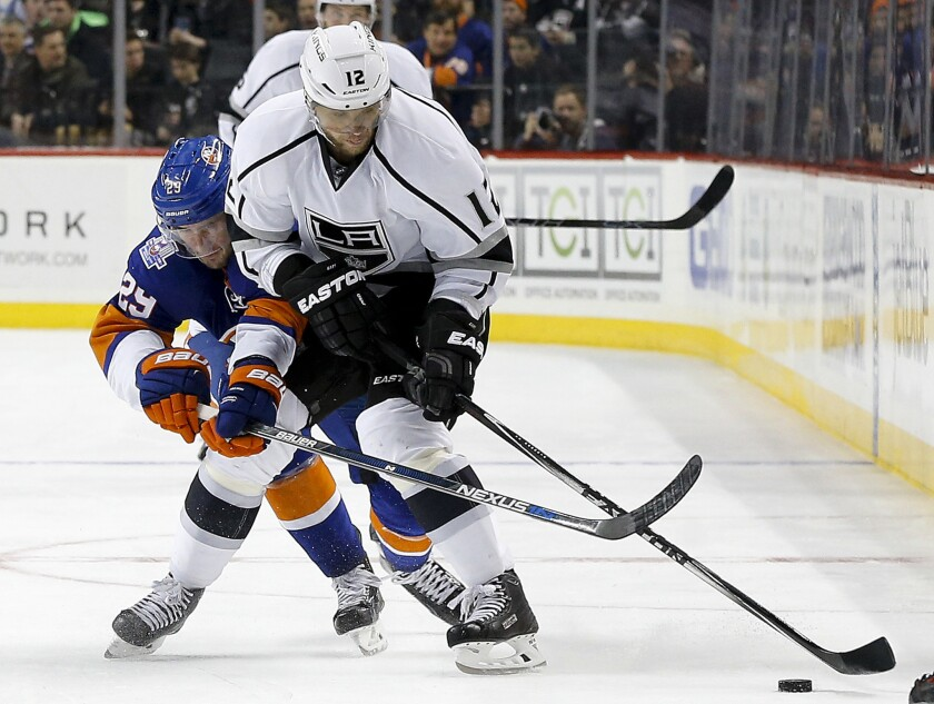 Islanders center Brock Nelson (29) battles for the puck against Kings right wing Marian Gaborik (12) during the third period of a game on Feb. 11.