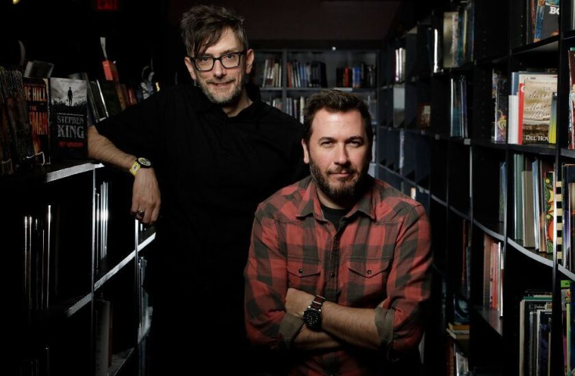 """""""Pet Sematary"""" co-directors Kevin Kölsch, left, and Dennis Widmyer make the leap from indie horror to the Stephen King reboot with a twist on the literary horror tale about grief, guilt, parenthood and trauma. They were photographed at Burbank's Dark Delicacies bookstore."""