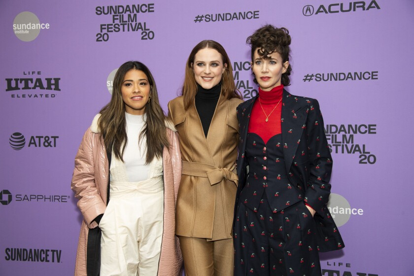 "FILE - Actors, from left, Gina Rodriguez and Evan Rachel Wood pose with writer-director Miranda July at the premiere of ""Kajillionaire"" during the 2020 Sundance Film Festival in Park City, Utah on Jan. 25, 2020. The film is about a family of grifters in Los Angeles. (Photo by Arthur Mola/Invision/AP, File)"