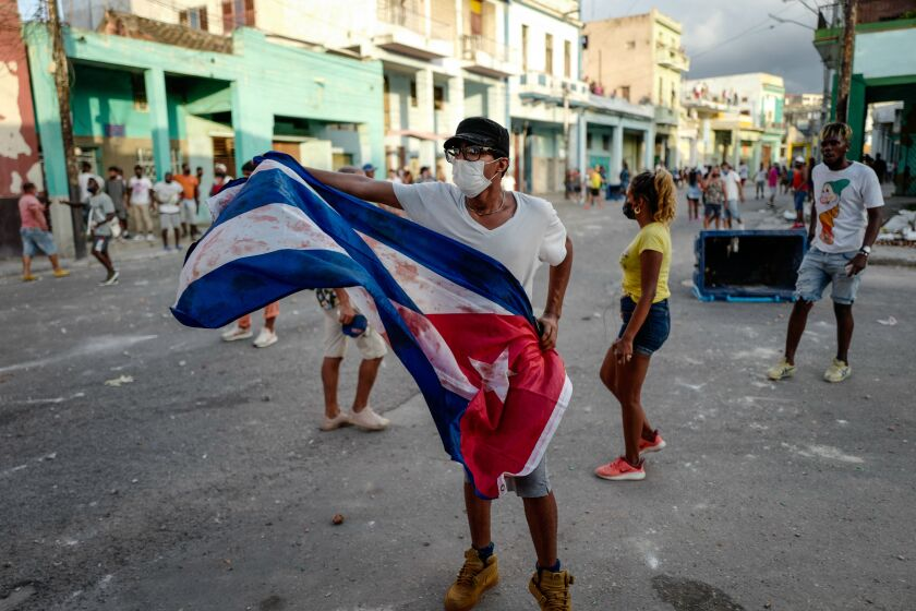A man waves a Cuban flag at a protest in Havana against the Cuban government on July 11.