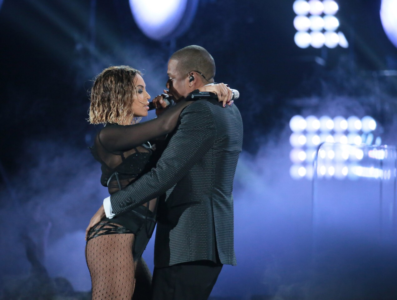 """Hip-hop siren and entrepreneur Beyonce opens the Grammys with husband and hip-hop mogul Jay Z, singing the track """"Drunk in Love."""" The pair amass massive cheers from the audience."""