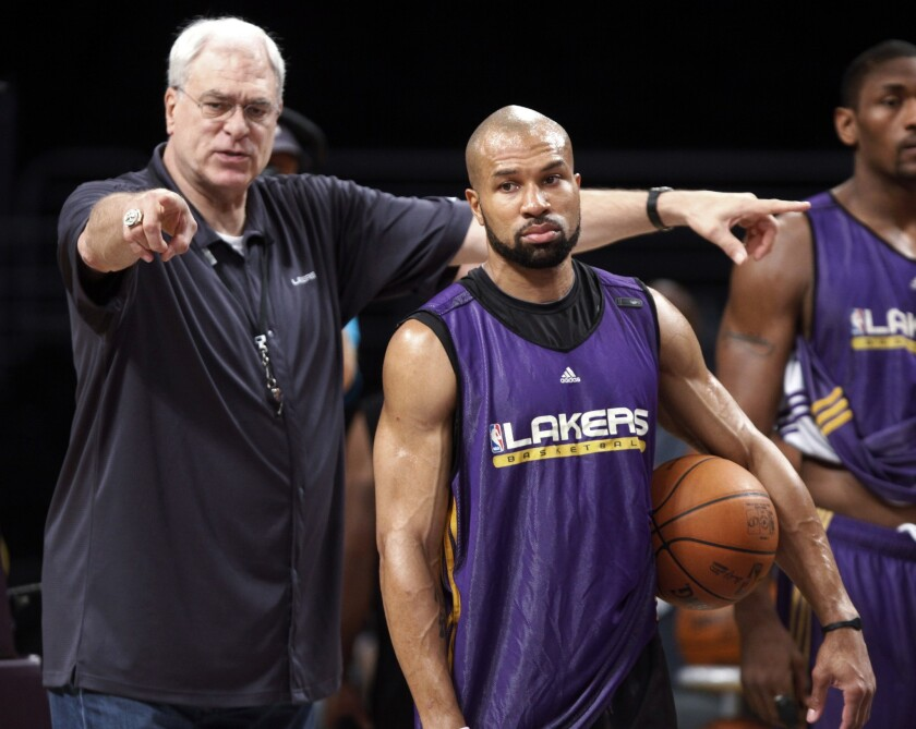 Former Lakers Coach Phil Jackson and Derek Fisher, pictured in 2010, will be reunited in New York after the former guard was named the Knicks' new head coach Monday.