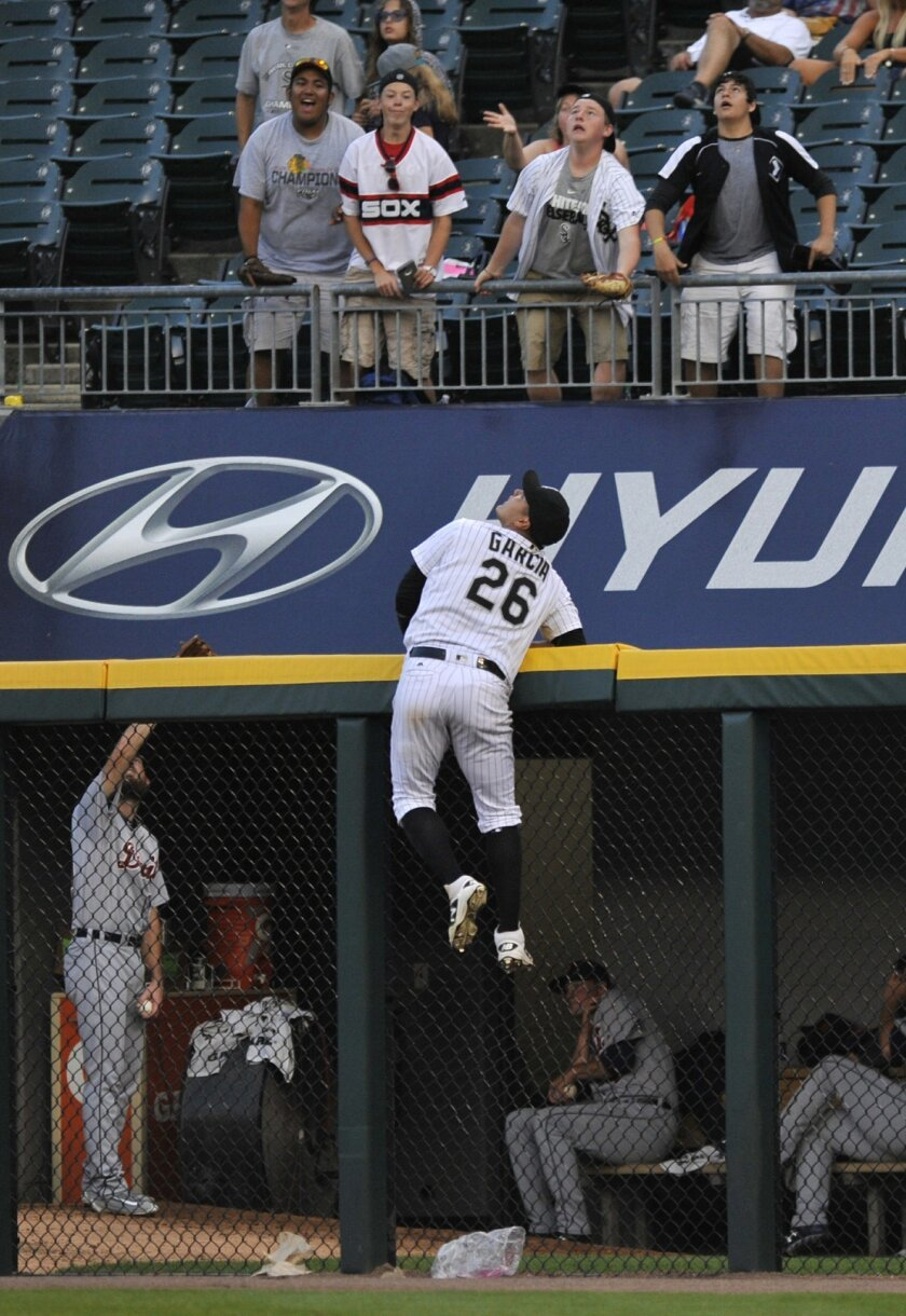 Chicago White Sox right fielder Avisail Garcia watches a three-run home run by Detroit Tigers' Justin Upton during the 11th inning of a baseball game Monday, Sept. 5, 2016, in Chicago. Detroit won 5-3. (AP Photo/Paul Beaty)