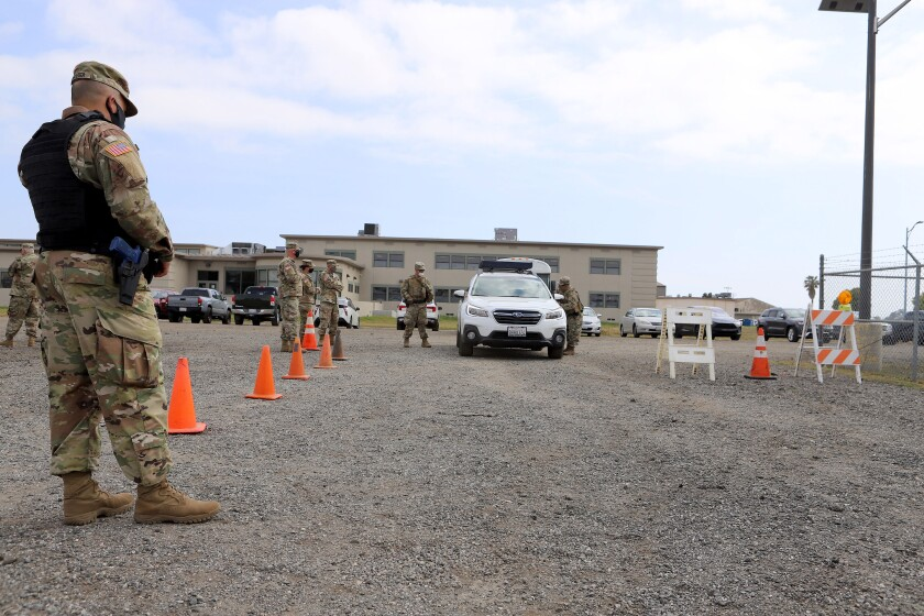 The California State Guard's Emergency Response Command practices operating a traffic control post.