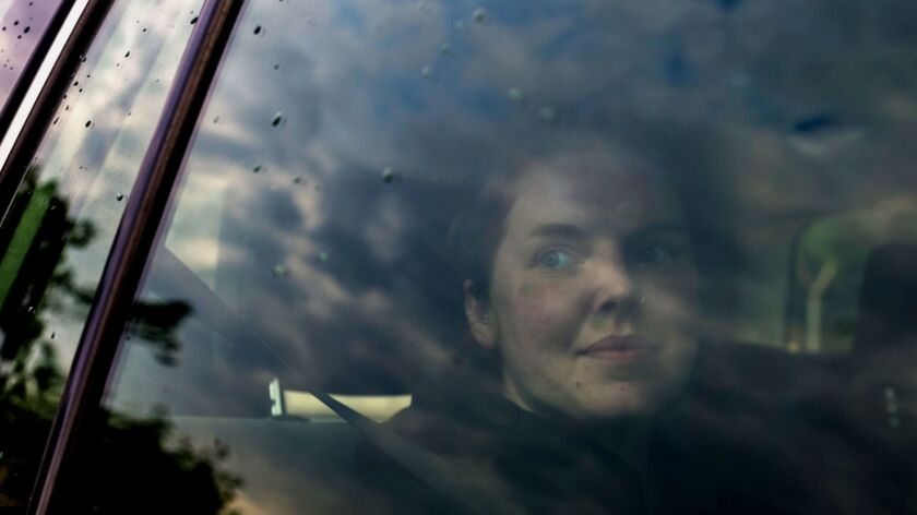 Martha O'Donovan sits in the back of a U.S. Embassy vehicle as she leaves Chikurubi Maximum Prison near Harare on Nov. 10, 2017.