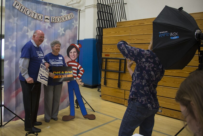 Charlie and Mary Leigh Blek of Trabuco Canyon get their photo taken with a cardboard cutout of Rep. Mimi Walters during a town hall meeting that Walters did not attend at Northwood High School on May 9 in Irvine.