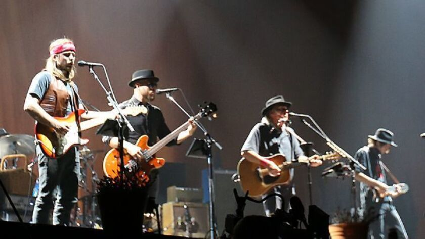 INDIO, CALIF. - OCT. 15, 2016. Neil Young performs with his band at weekend 2 of Desert Trip in Ind