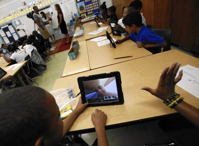 Muhammad Nassar Jr. takes a picture of himself as Karen Finkel's class explores their new iPads at Broadacres Elementary School in Carson in August 2013.