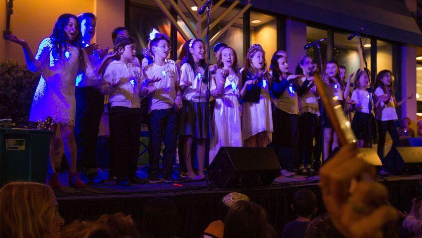 Tarbut V'Torah Childrens Choir sing during the menorah lighting ceremony celebrating the first night