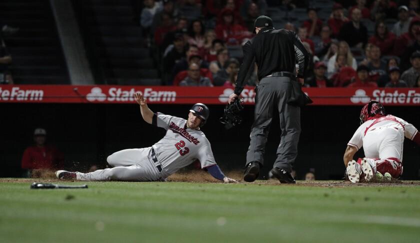 ANAHEIM, CA - MAY 12, 2018: Minnesota Twins catcher Mitch Garver (23) scores as Los Angeles Angels