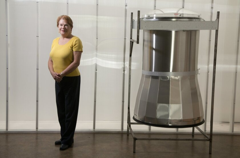 Michele Nash-Hoff, president of ElectroFab Sales, and is an author on manufacturing issues, stands by Solatube International's newest product, the SkyVault. SolaTube is one of several US companies to return manufacturing from overseas plants back to America.